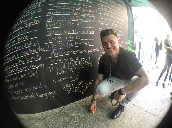 Shawn Hook posing with the Why Music Matters wall at the TD Union Block Party
